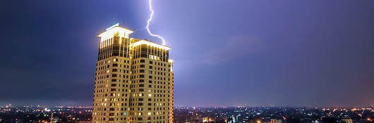 Lightning striking a building in a thunderstorm