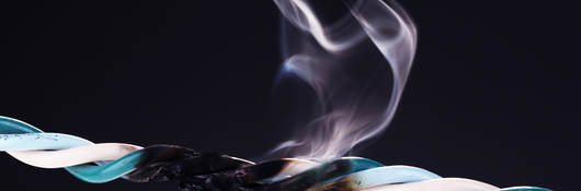 Non-low smoke halogen free (LSHF) cable that has combusted, generating smoke and fumes.