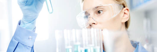 Photo of young woman working in laboratory