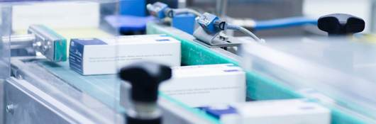 Medical products move on a production conveyer belt