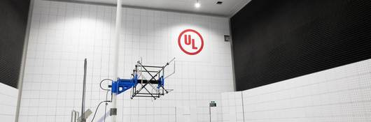 Large EMC chamber with antenna in laboratory with red UL logo