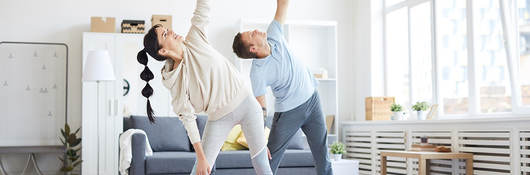 Photo of a couple doing yoga in activewear