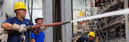 Photo of men in hardhats testing fire doors