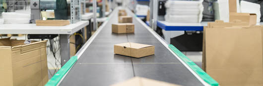 Photo of cardboard boxes on a conveyor belt