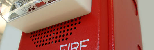 Fire alarm light on wall