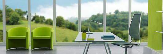 Open workspace with a desk and a view of the outside