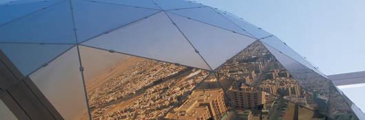 Glass prism reflecting city of Saudi Arabia