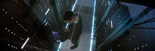 Top down view of man working in a data center