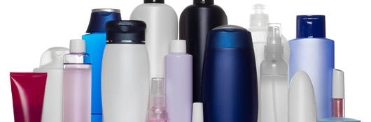 Cosmetic bottles on stand