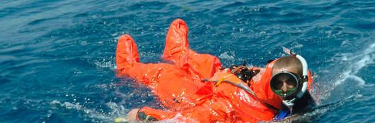 A diver rescuing a sailor