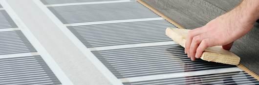 Person laying hardwood floor