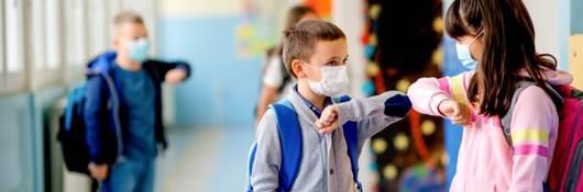 Children at School Wearing Masks Elbow Bumping