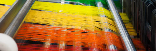 Colored thread in a textile factory