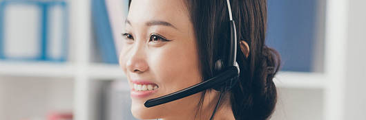 Woman taking a call with a headset