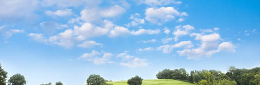 Open field with open blue sky