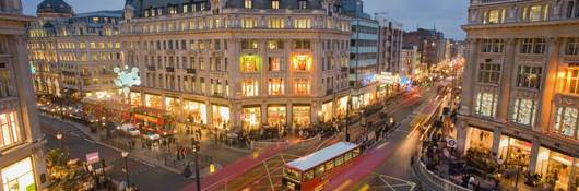 Buses and shoppers on the intersection of Oxford Street and Regent Street, London, England