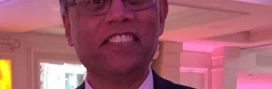 Headshot of Iqbal