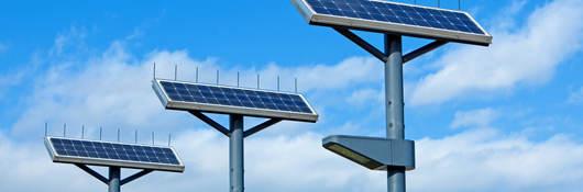 Photovoltaic solar streetlights against the morning sky.