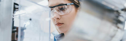 Female industrial worker working in manufacturing