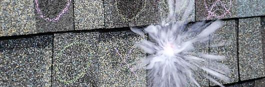 Close up of hail impact testing on shingles