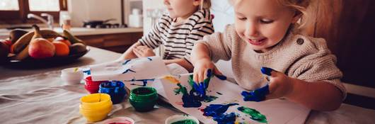Children playing with finger paints