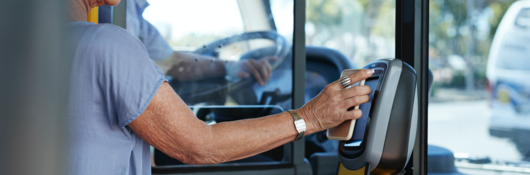 woman tapping a card in a bus
