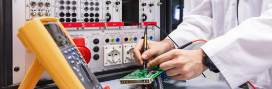 Engineer conducting electrical safety and performance tests