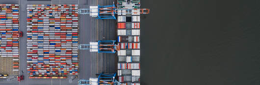Container ship docked in port as seen from above