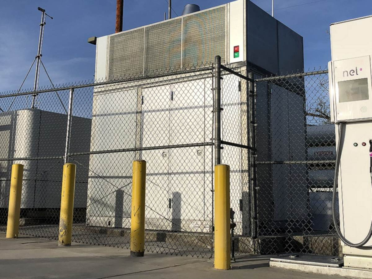 hydrogen fuel tank surrounding by fenced in cooling tanks