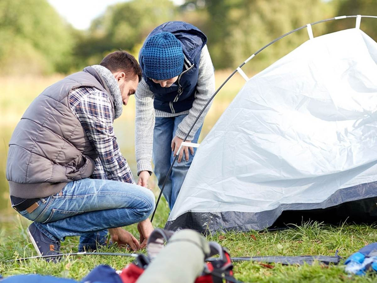 Couple setting up tent for a camping adventure