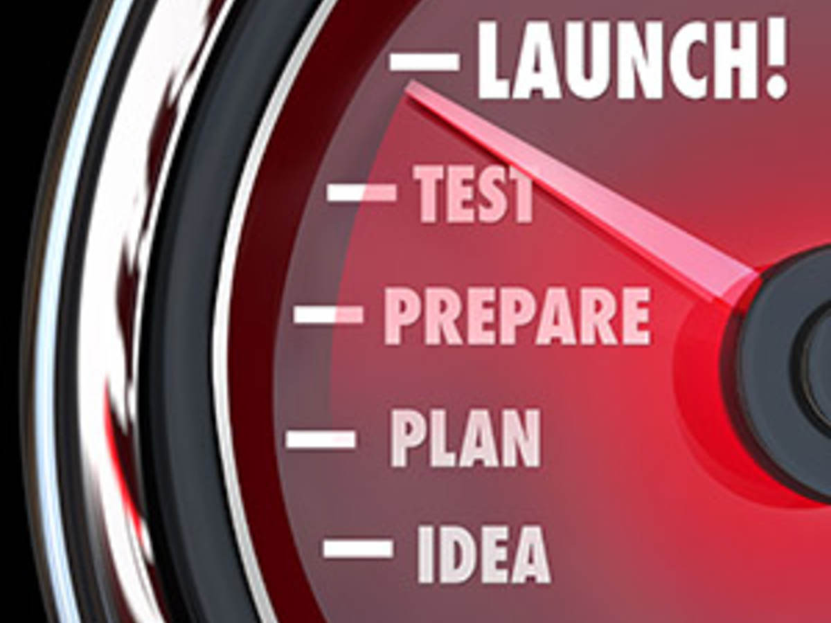 launch word on a red speedometer with needle racing past idea, plan, prepare and test.