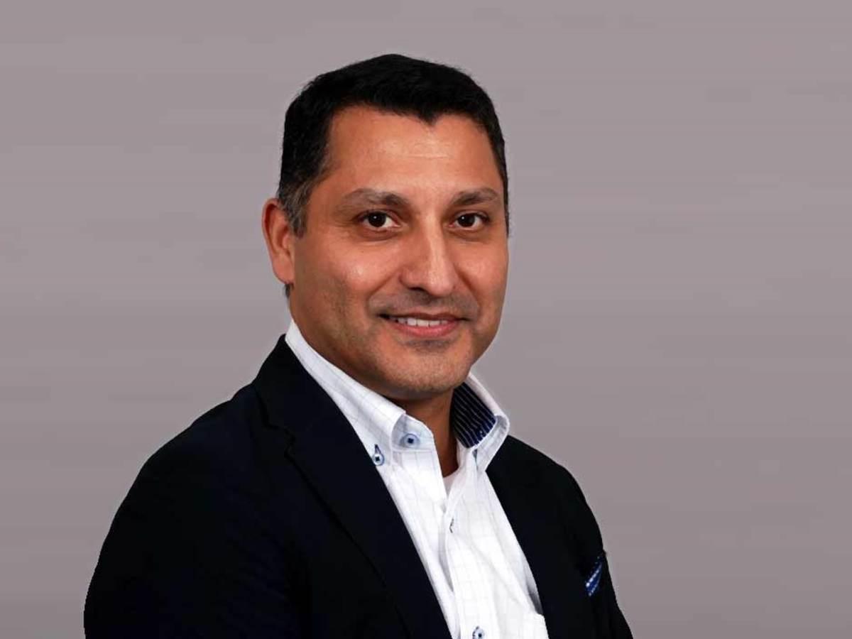 headshot of Zubin Dastoor.
