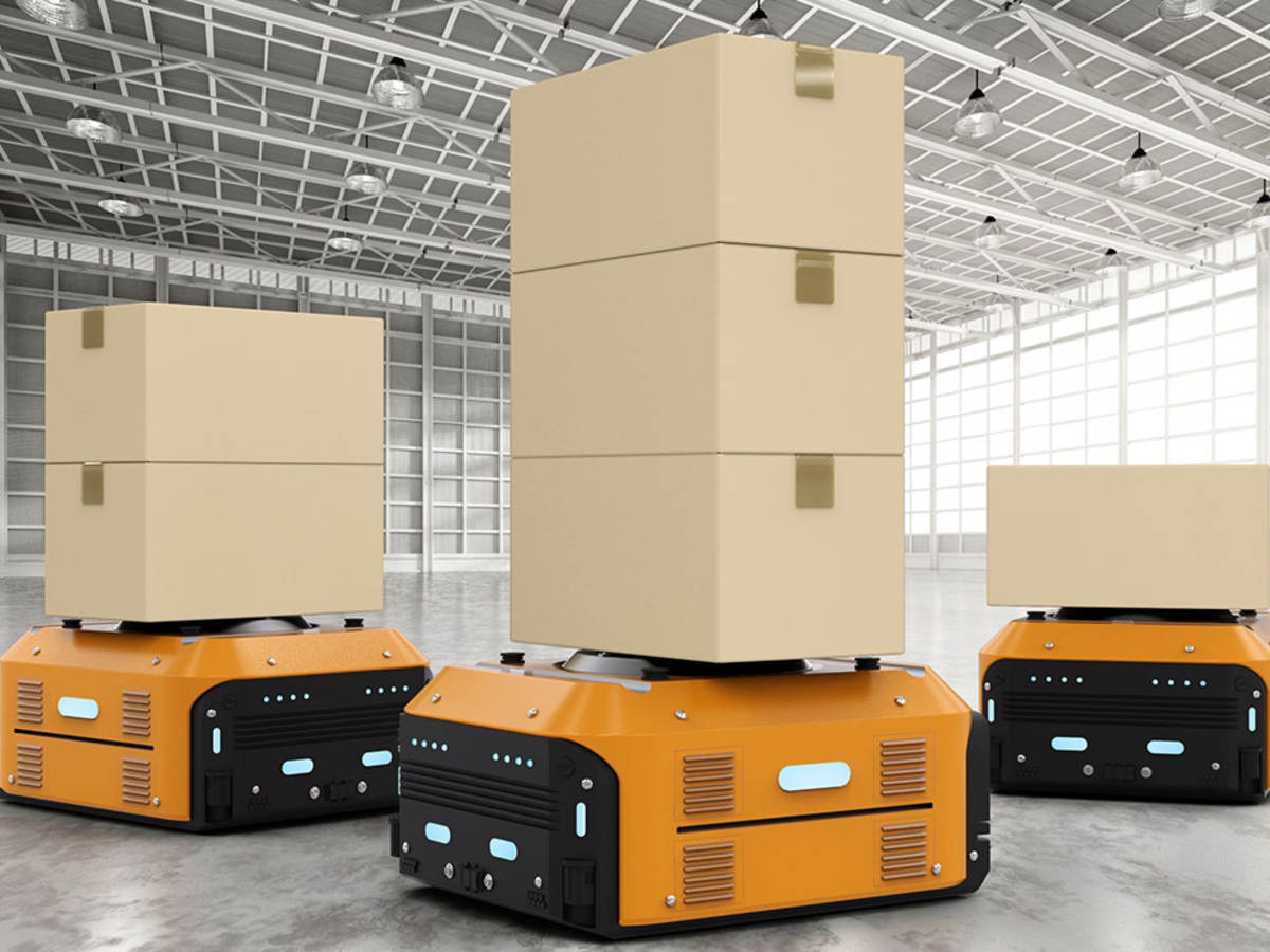 87951252 - 3d rendering warehouse robots carry boxes in factory