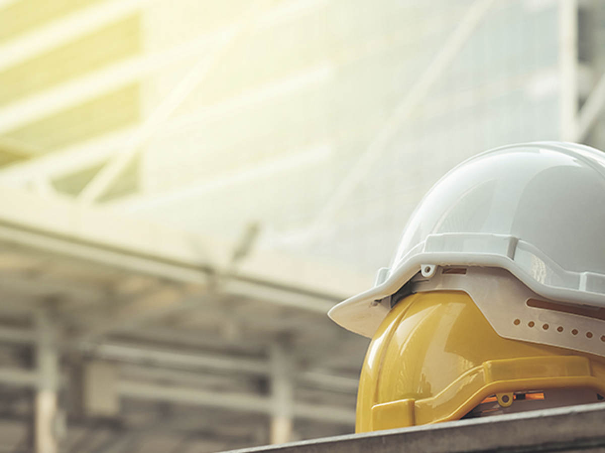 Image of yellow and white hard hats.
