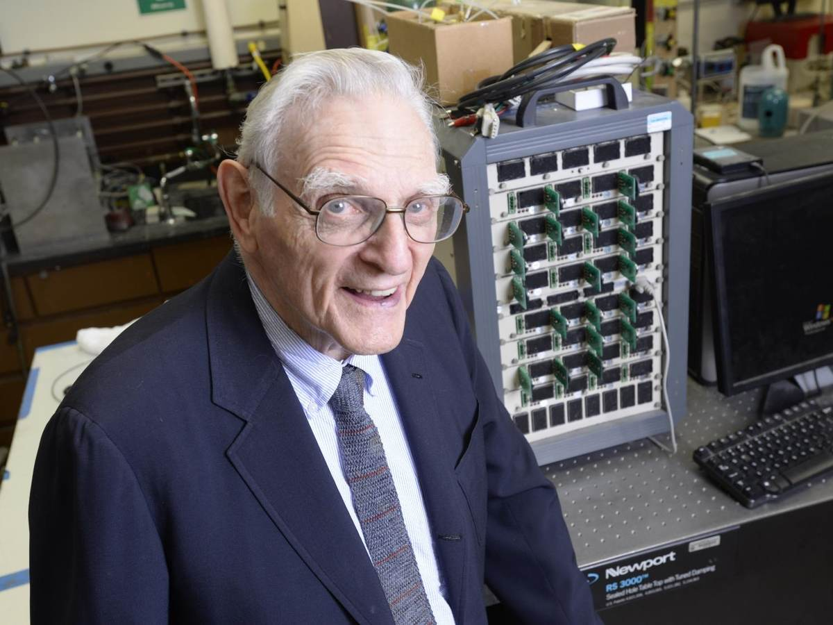 John Goodenough sitting in his lab in front of lab equipment