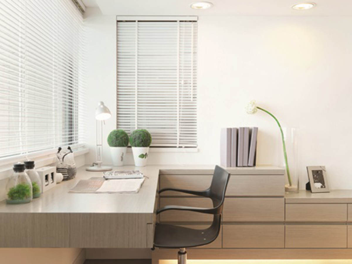 Modern office space with windows, desk and chair