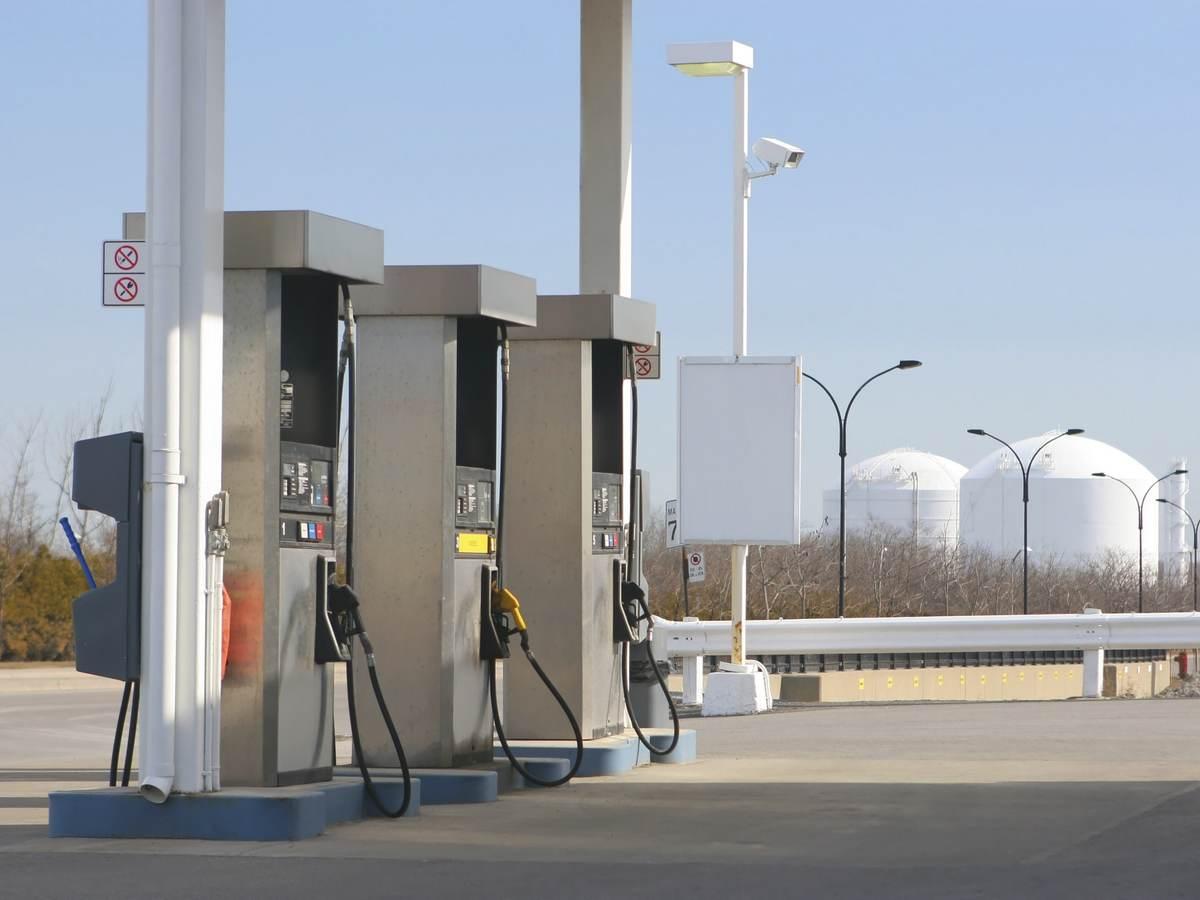 Three pumps at a gas station.