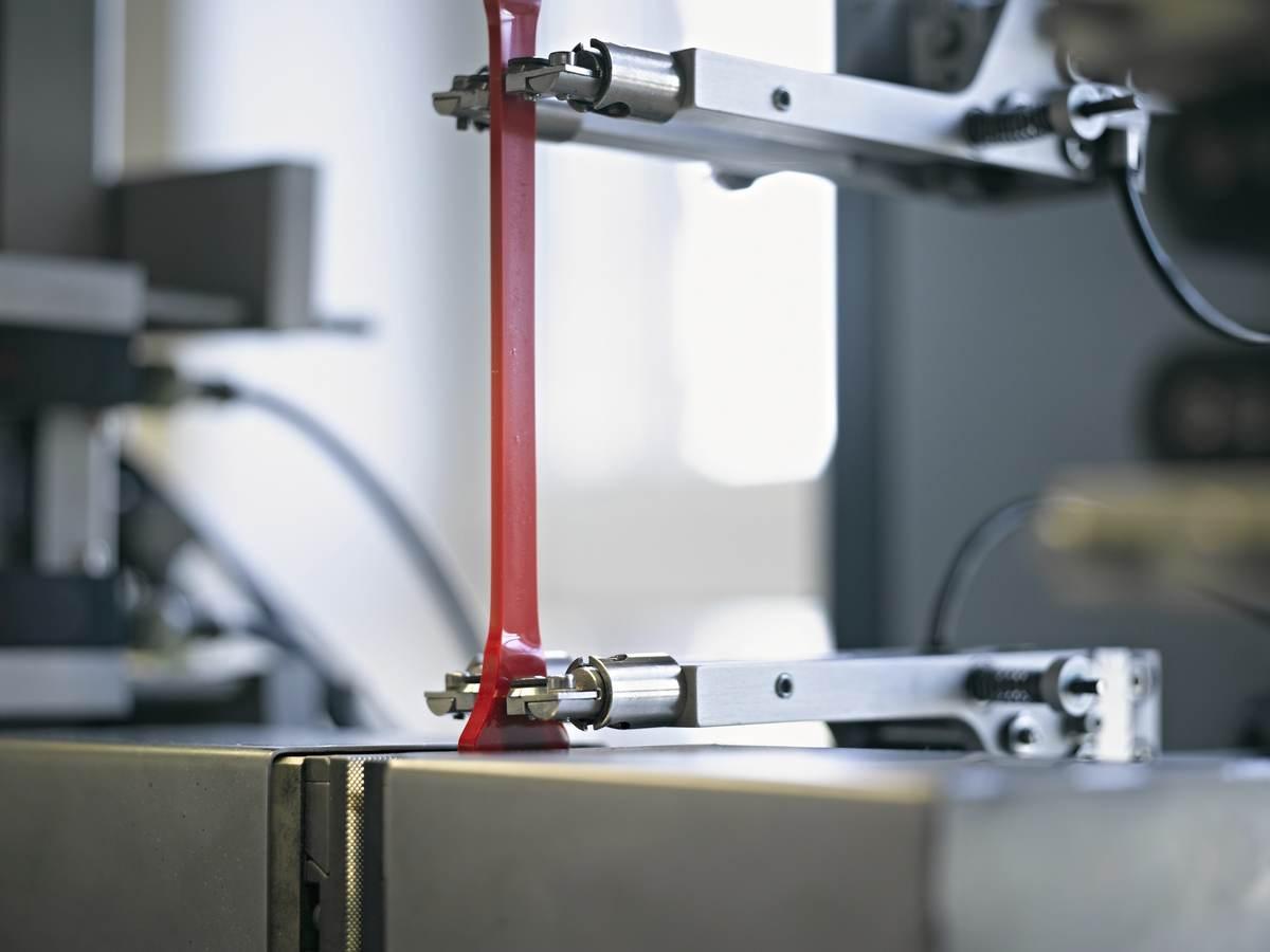 A machine testing a piece of plastic.