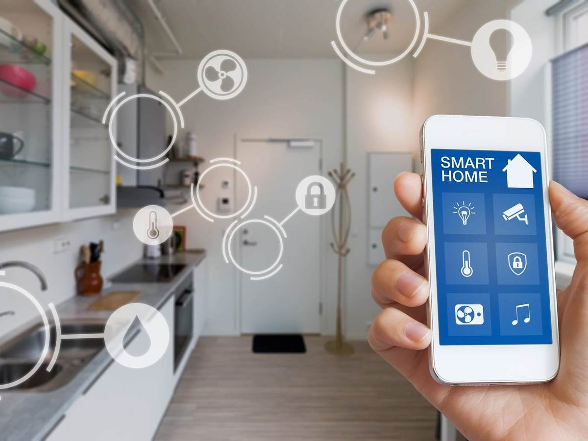 Cybersecurity graphics overlaid on a kitchen setting to denote a smart home.