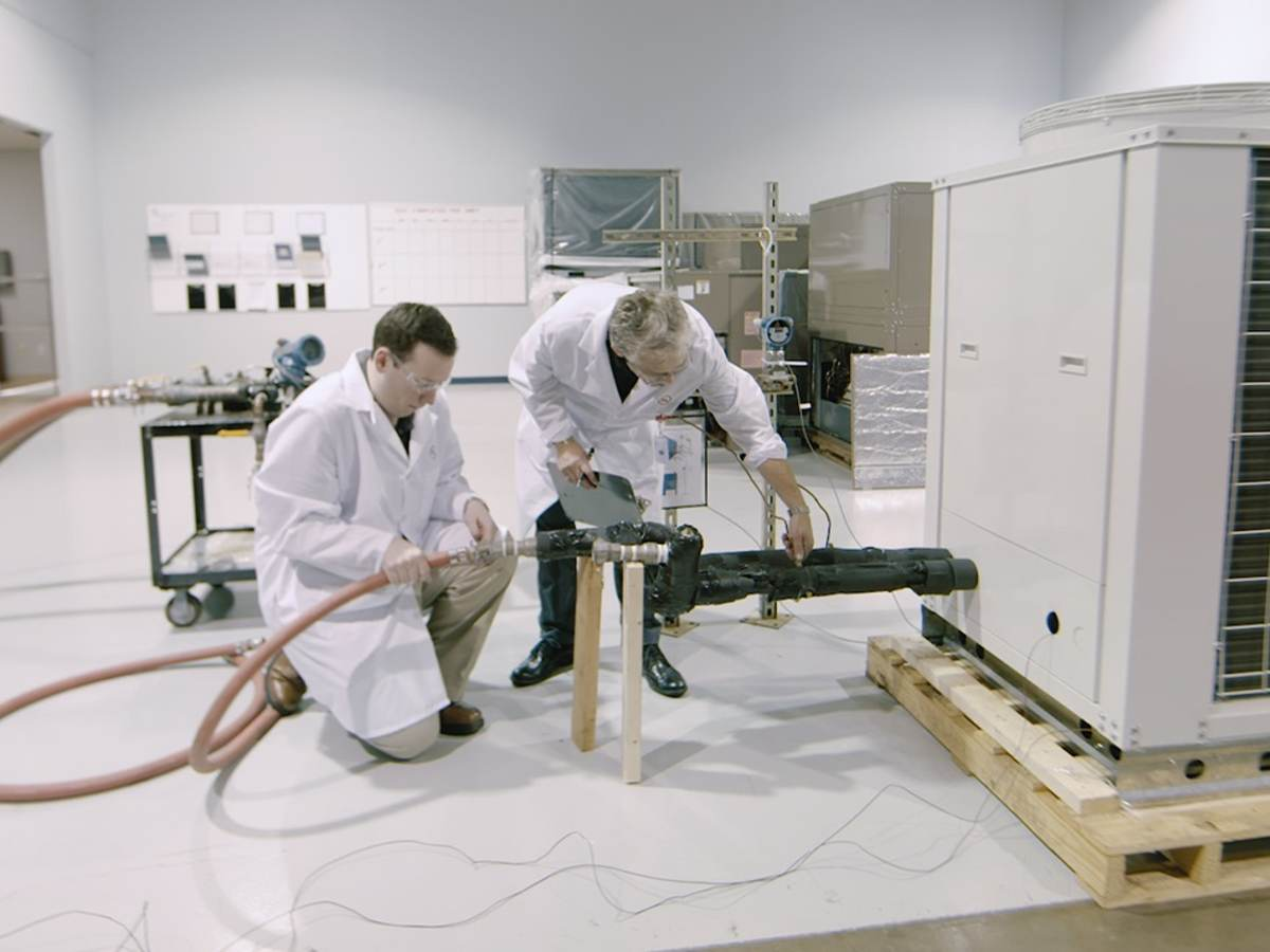 Two UL engineers testing an HVAC unit in a laboratory