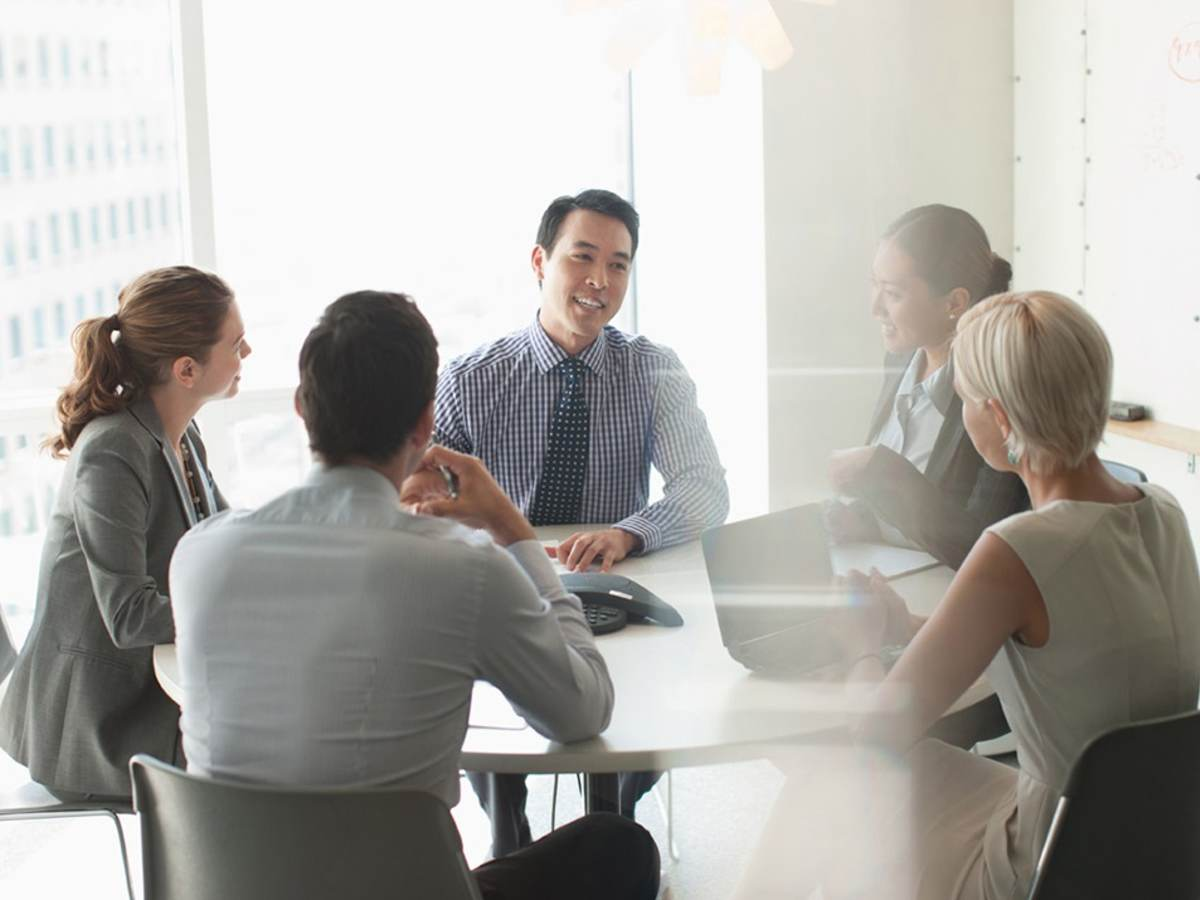 A group of business people in a meeting.