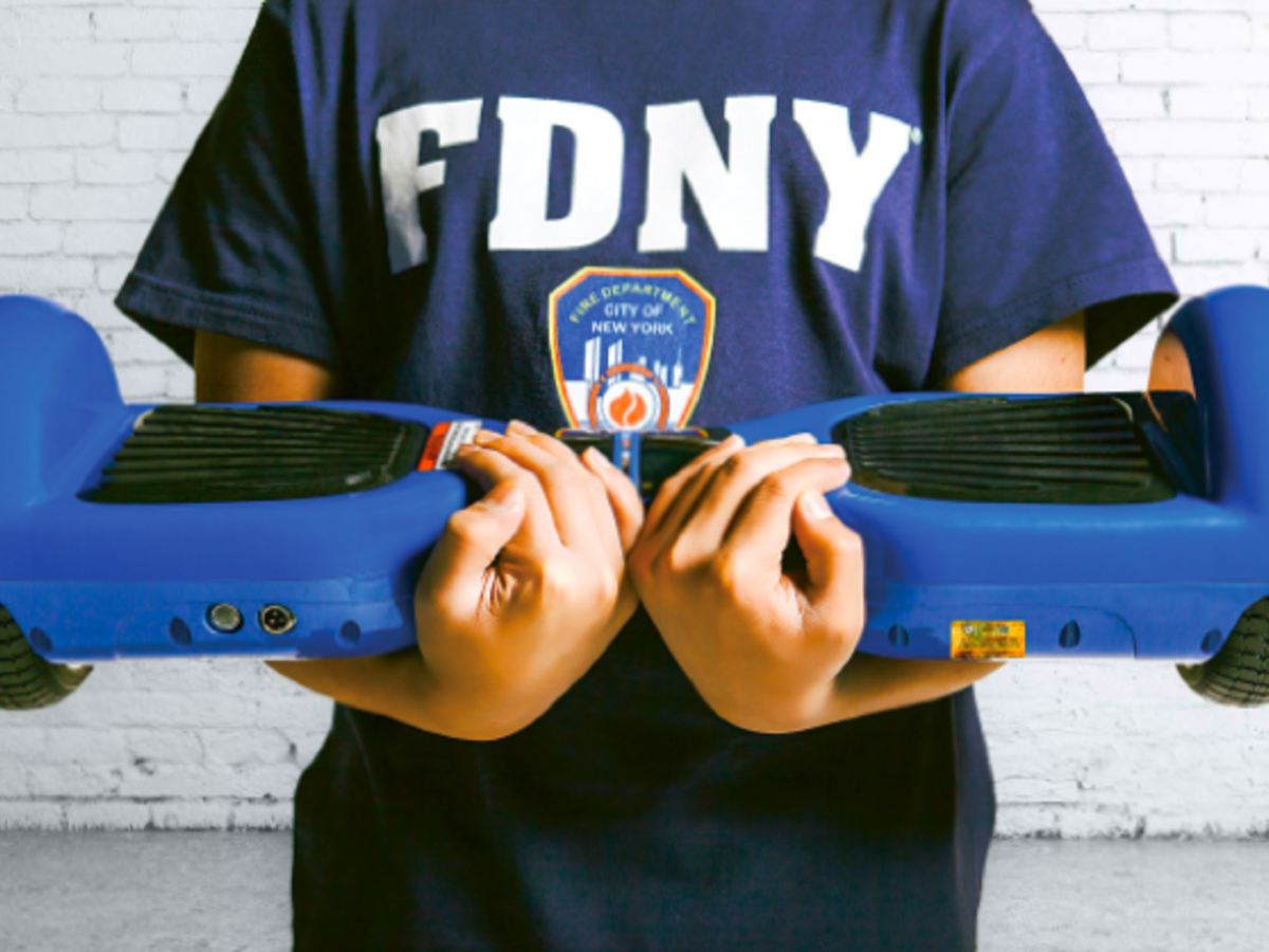 Person with FDNY tshirt holding a hover board