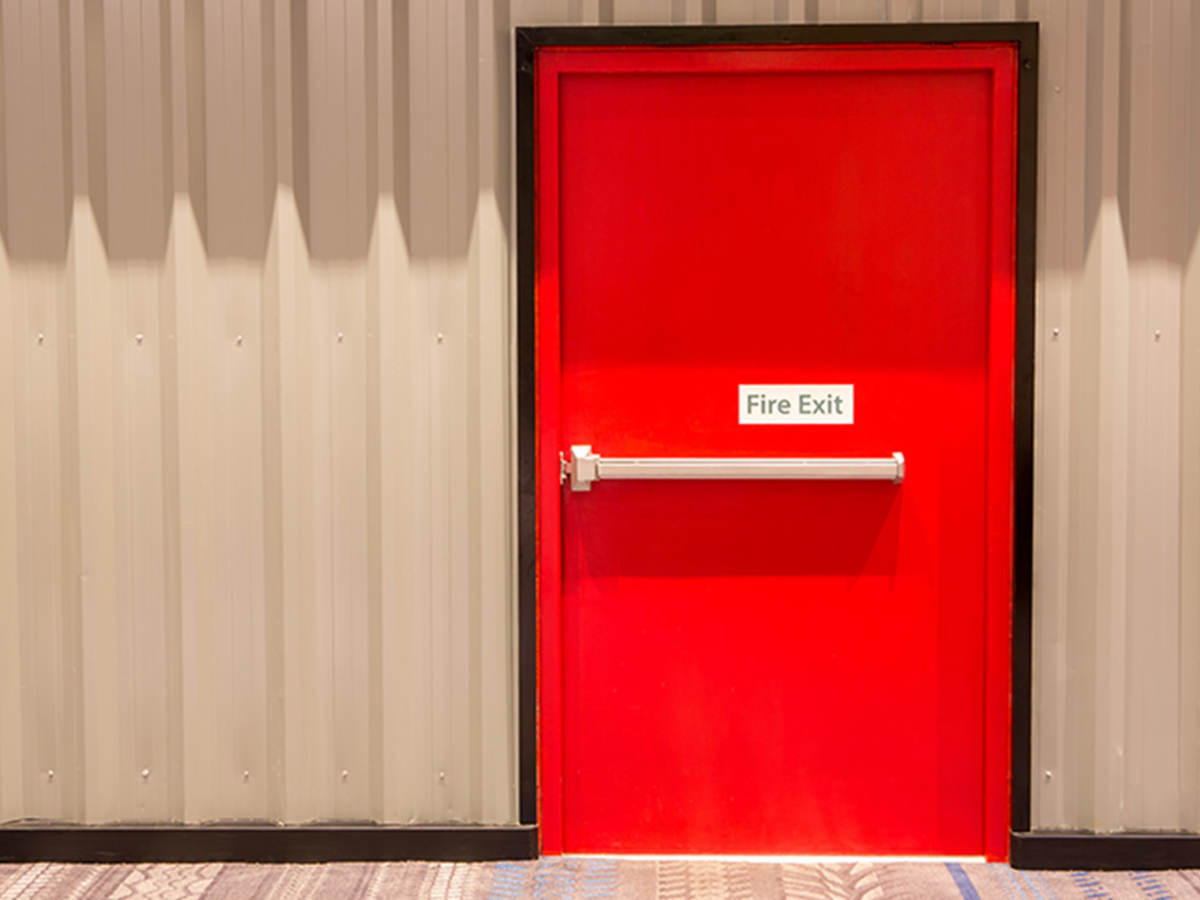 Red door with fire exit sign