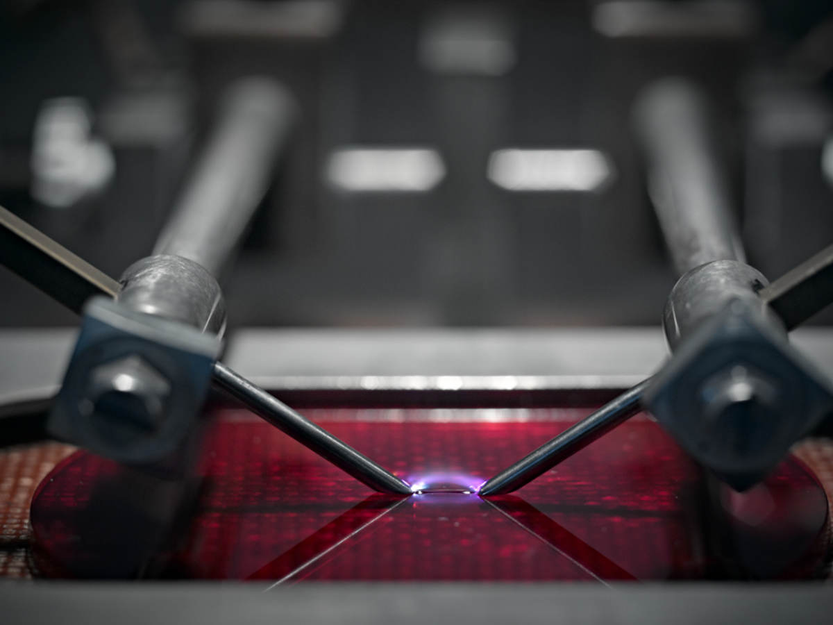 A close-up picture of a machine testing plastic.