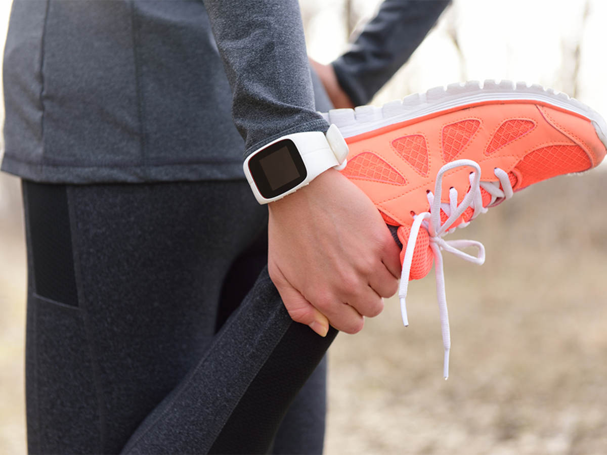 Runner wearing exercise clothing and sneakers