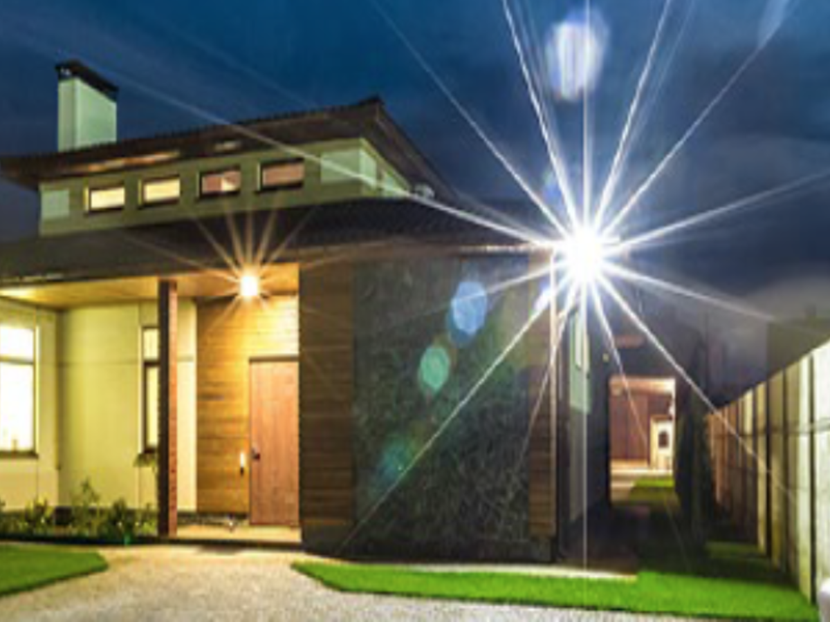 Outside view of modern home in evening with bright light shining outward