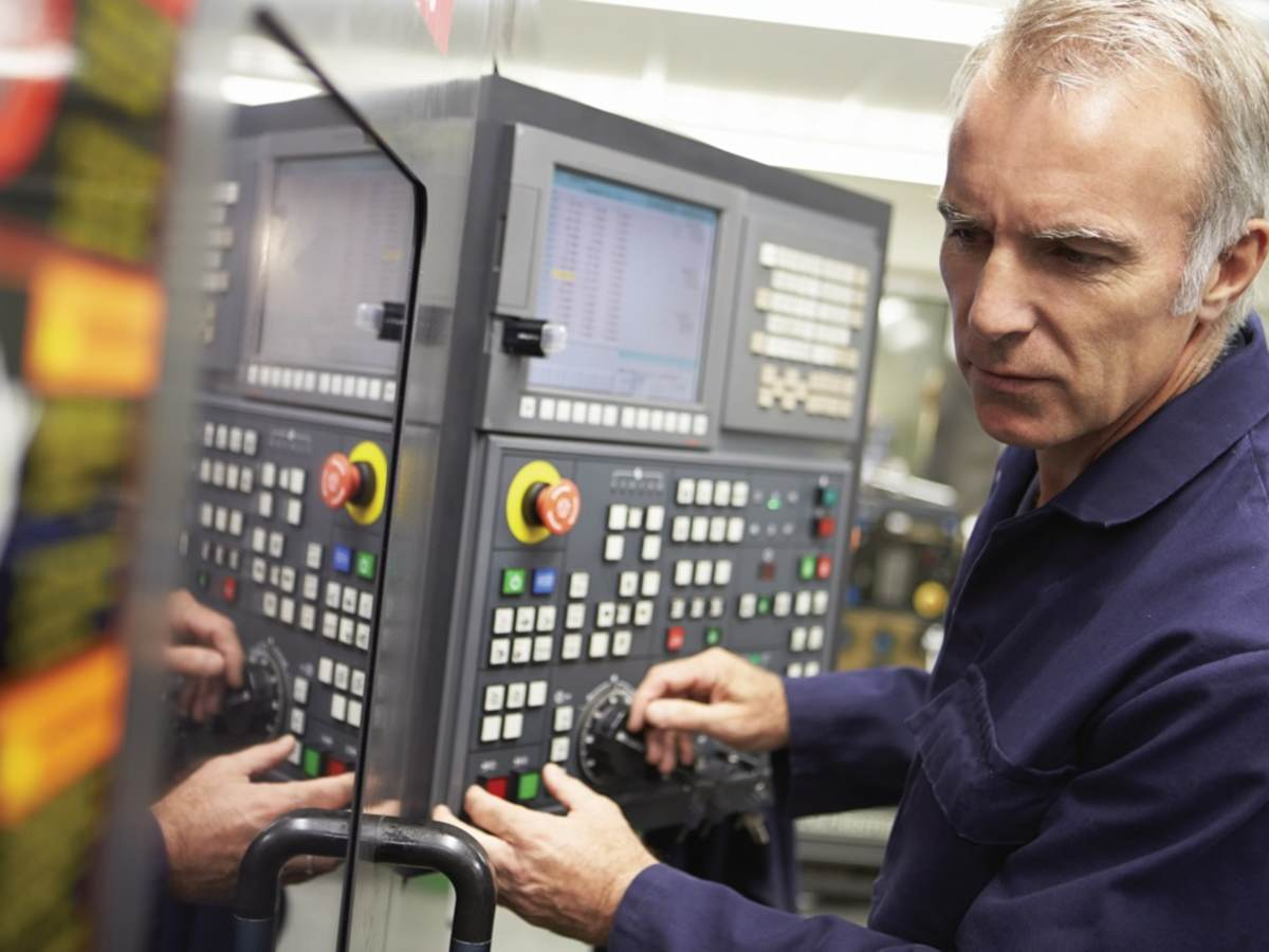 Technician working on an industrial control panel