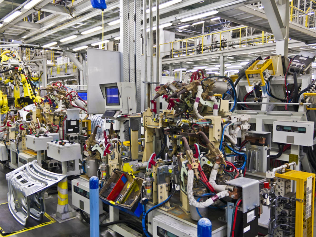 Robotic machines in a factory setting.