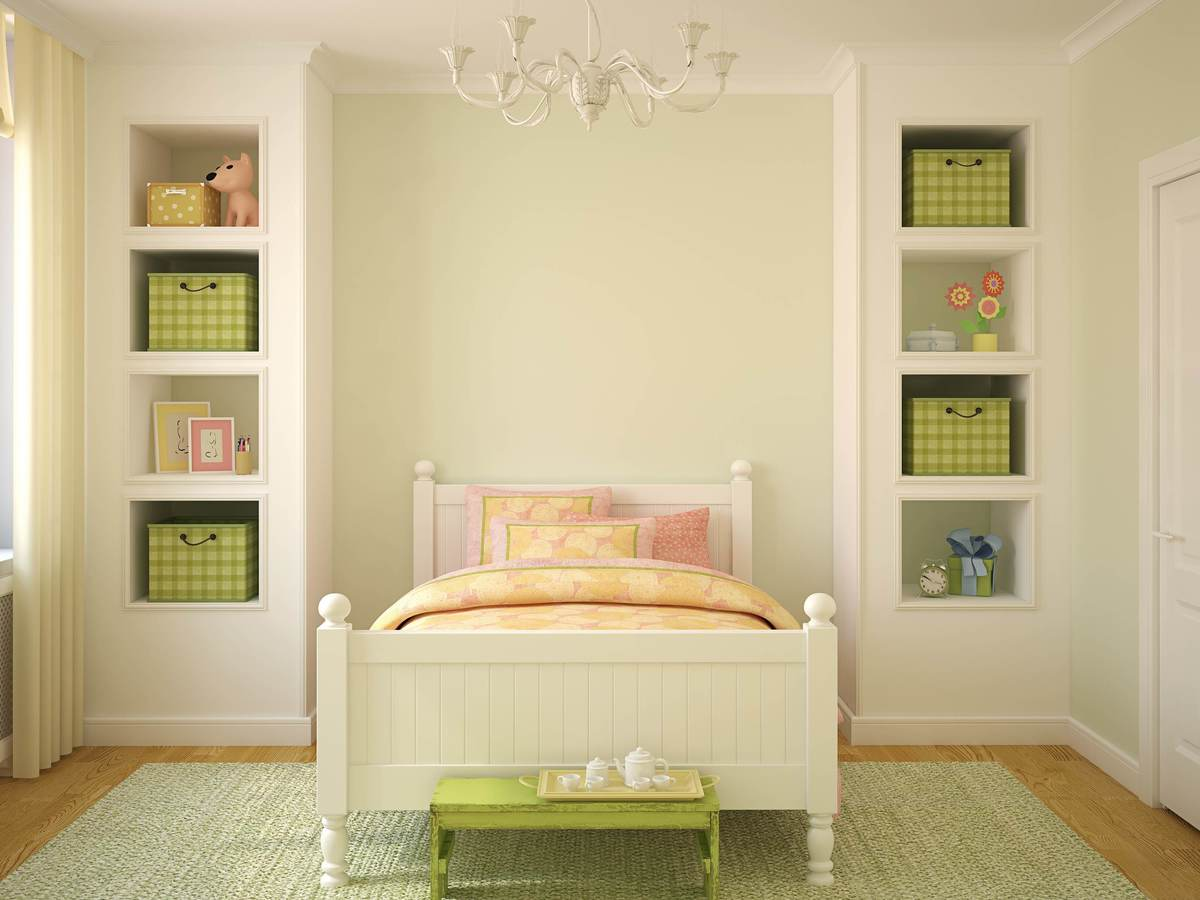 A child's bedroom, including a bed and shelving units.