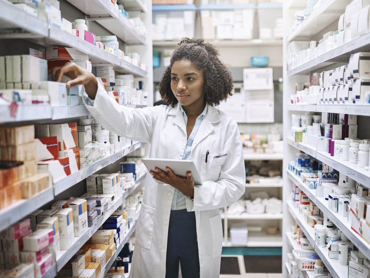 pharmacist with a tablet